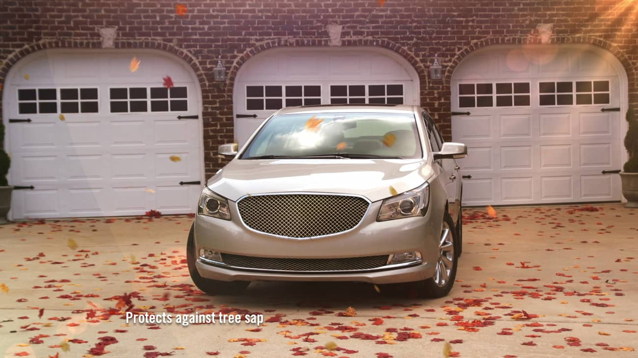 Gold sedan in front of a garage showing how ResistAll will protect the vehicle from the elements